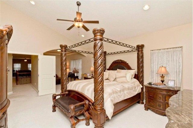 Inspiration for a large timeless master carpeted bedroom remodel in Columbus with beige walls and no fireplace