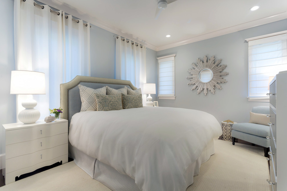Inspiration for a mid-sized transitional guest dark wood floor bedroom remodel in Miami with blue walls