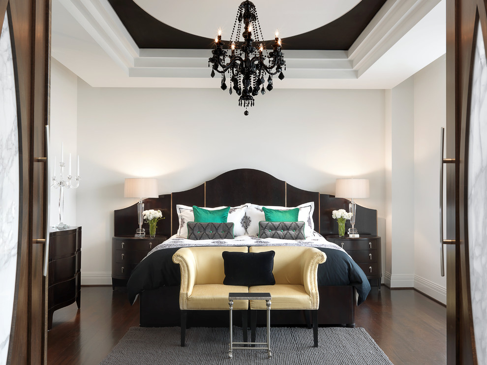 Inspiration for a contemporary dark wood floor bedroom remodel in St Louis with white walls