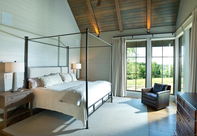 Inspiration for a mid-sized cottage master light wood floor and beige floor bedroom remodel in Nashville with white walls and no fireplace