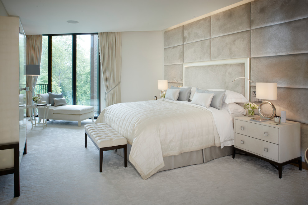 Inspiration for a mid-sized contemporary carpeted bedroom remodel in London with white walls