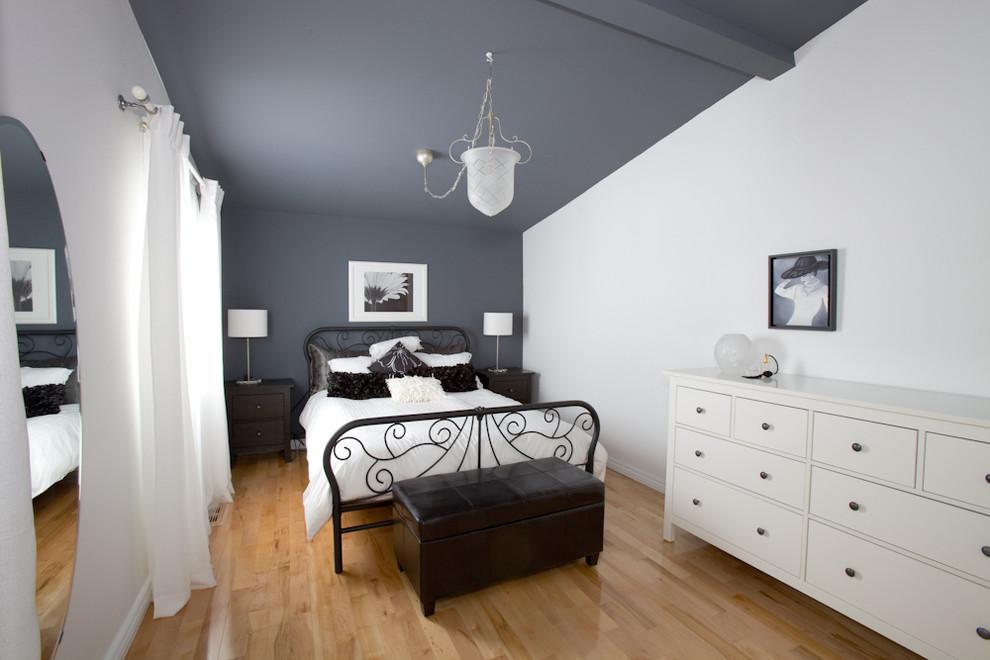 Trendy light wood floor bedroom photo in Montreal with gray walls