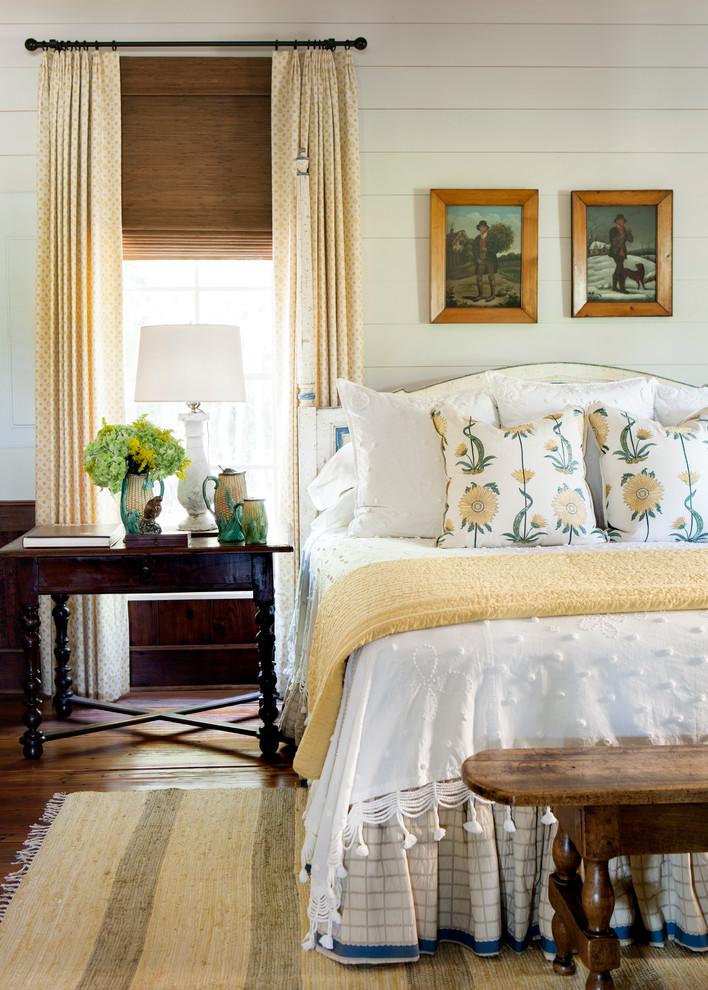 Bedroom - country master medium tone wood floor bedroom idea in Atlanta with white walls