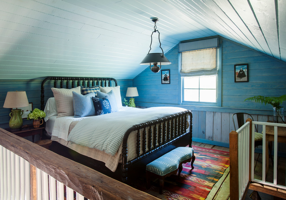 Example of a cottage loft-style bedroom design in Atlanta with blue walls