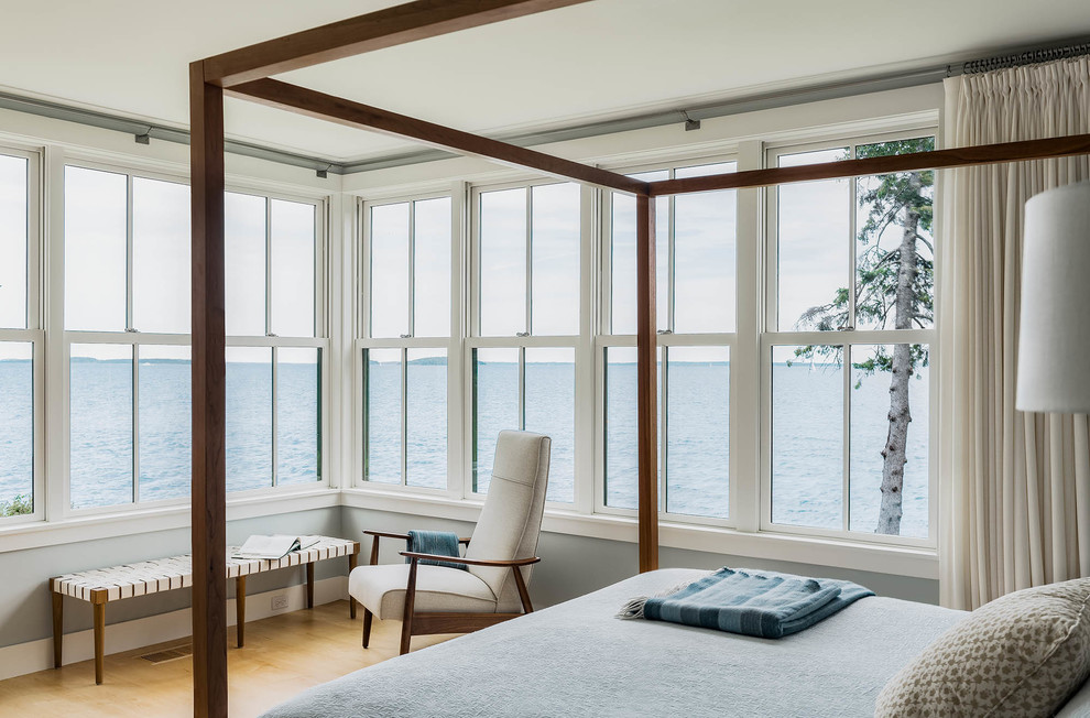 Inspiration for a large coastal master light wood floor bedroom remodel in Portland Maine with blue walls