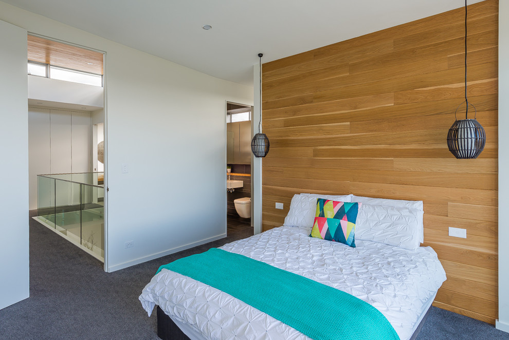 Inspiration for a contemporary master bedroom in Sydney with white walls and carpet.