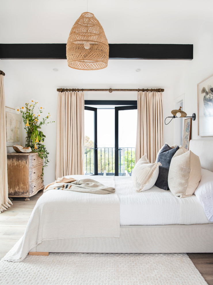 Inspiration for a contemporary dark wood floor and brown floor bedroom remodel in Los Angeles with white walls