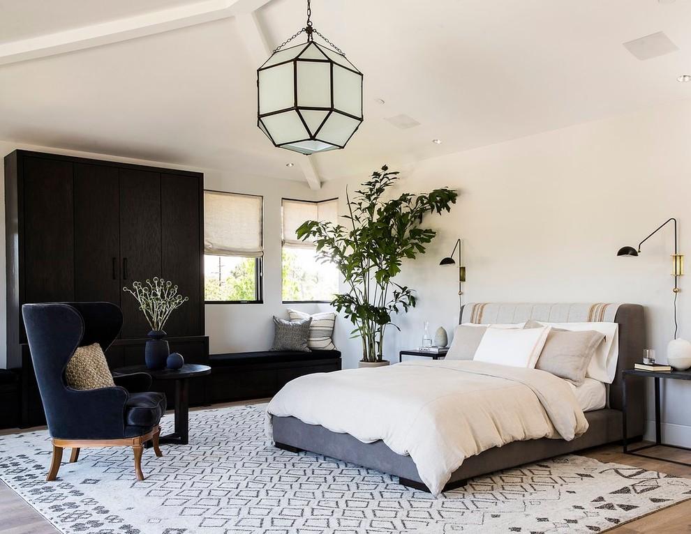 Bedroom - contemporary medium tone wood floor bedroom idea in Los Angeles with white walls