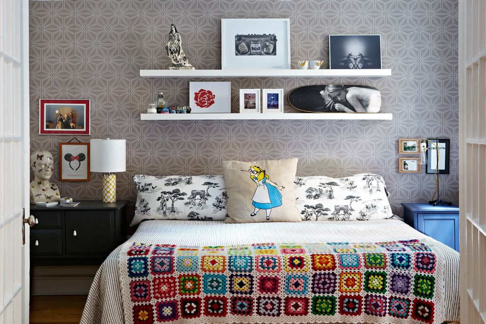 Example of an eclectic bedroom design in New York with gray walls