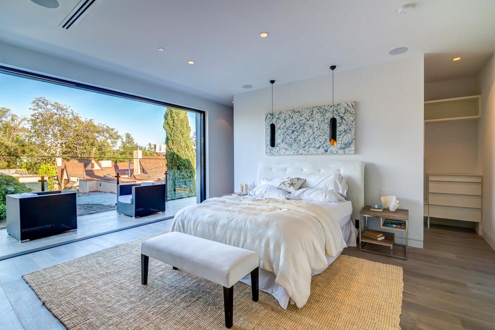 Example of a trendy dark wood floor bedroom design in Los Angeles with white walls