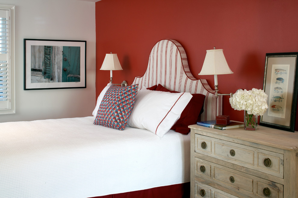 Mid-sized beach style guest medium tone wood floor bedroom photo in Boston with red walls
