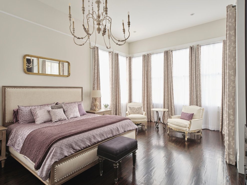 Example of a classic master medium tone wood floor and brown floor bedroom design in New Orleans with beige walls and no fireplace