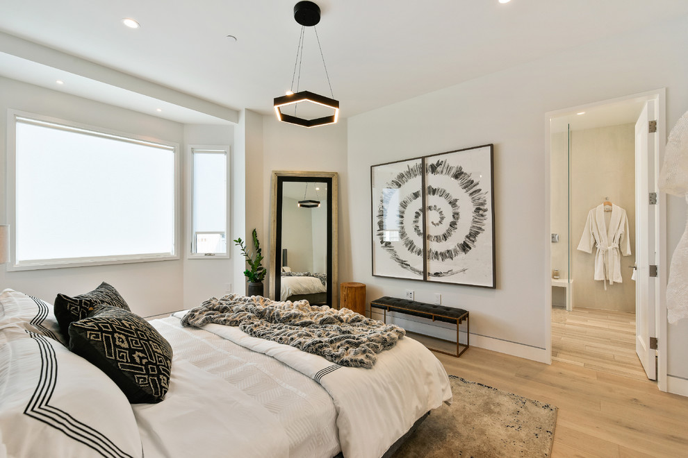 Inspiration for a contemporary master light wood floor and beige floor bedroom remodel in San Francisco with white walls