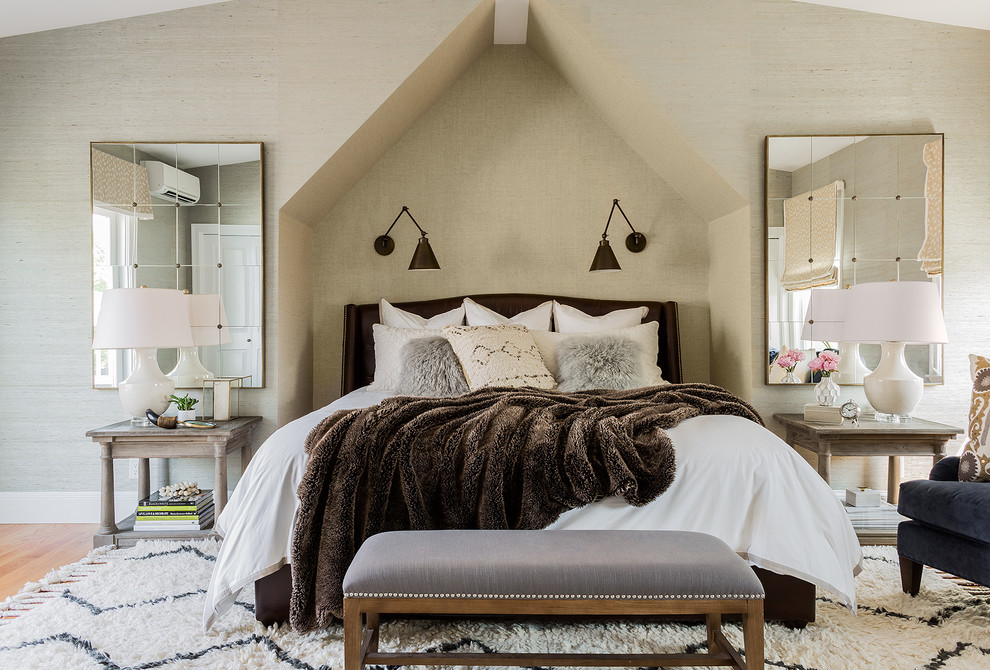 Example of a transitional light wood floor bedroom design in Boston with gray walls