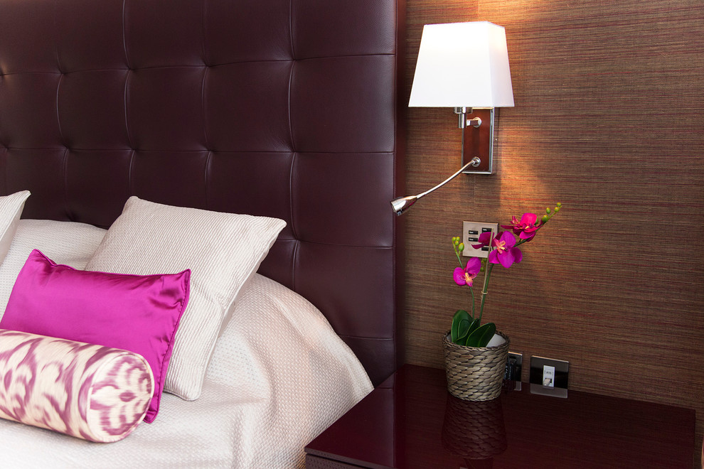 Bedroom - mid-sized contemporary master carpeted bedroom idea in London with purple walls and no fireplace