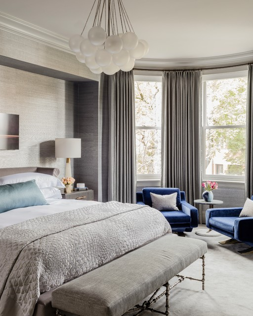 Example of a large transitional master carpeted and gray floor bedroom design in Boston with gray walls and no fireplace