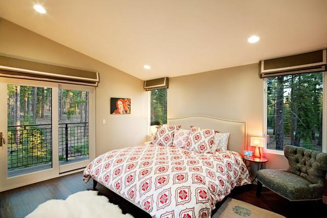 Example Of A Trendy Dark Wood Floor Bedroom Design In Sacramento With Beige  Walls