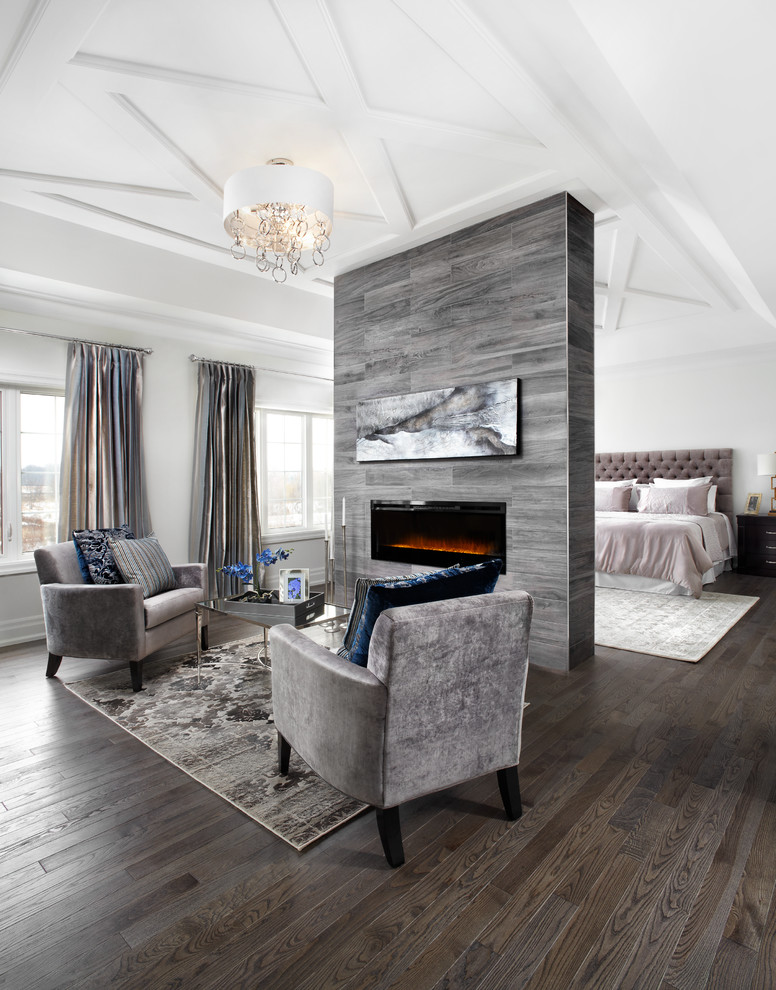 Example of a huge transitional master dark wood floor bedroom design in Toronto with white walls and a ribbon fireplace