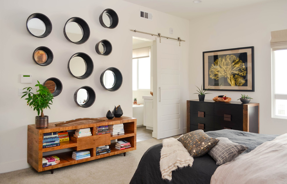 Example of a huge urban master carpeted and beige floor bedroom design in Los Angeles with white walls and no fireplace