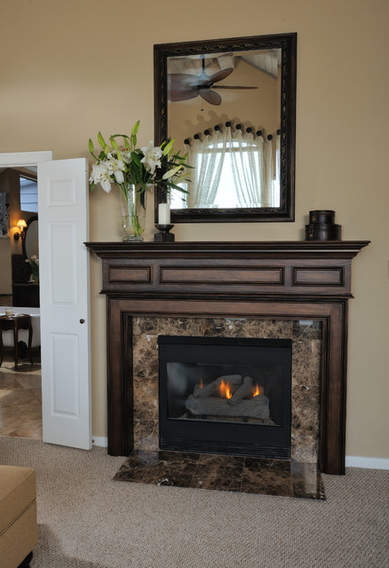 Inspiration for a timeless carpeted bedroom remodel in Houston with beige walls, a standard fireplace and a stone fireplace