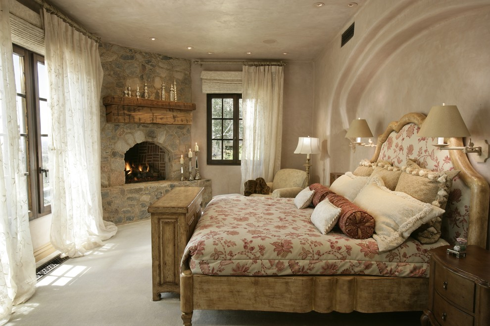 Example of a mountain style bedroom design in Phoenix with a corner fireplace and a stone fireplace