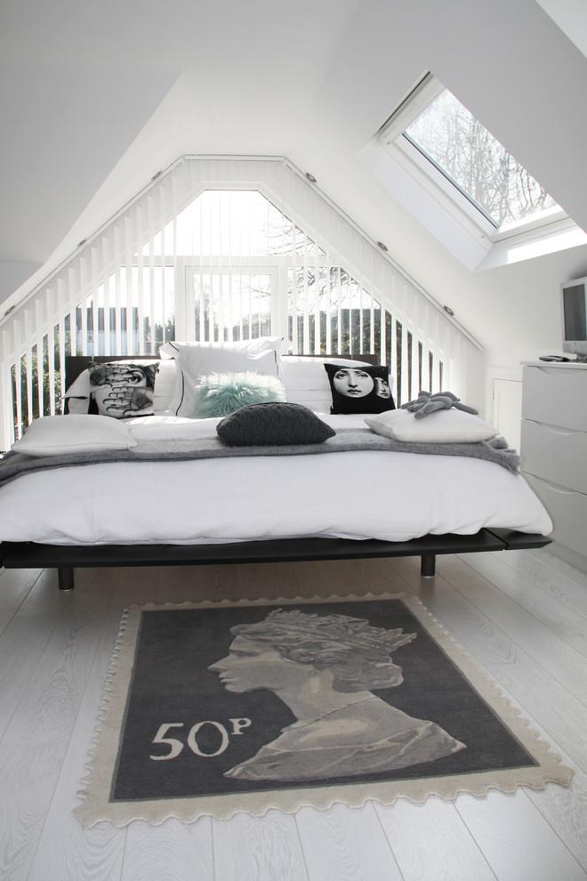 Bedroom - scandinavian painted wood floor and gray floor bedroom idea in London with white walls