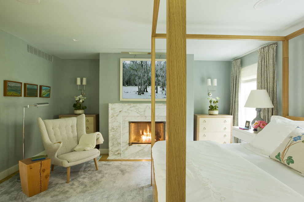Bedroom - contemporary master bedroom idea in New York with blue walls and a standard fireplace