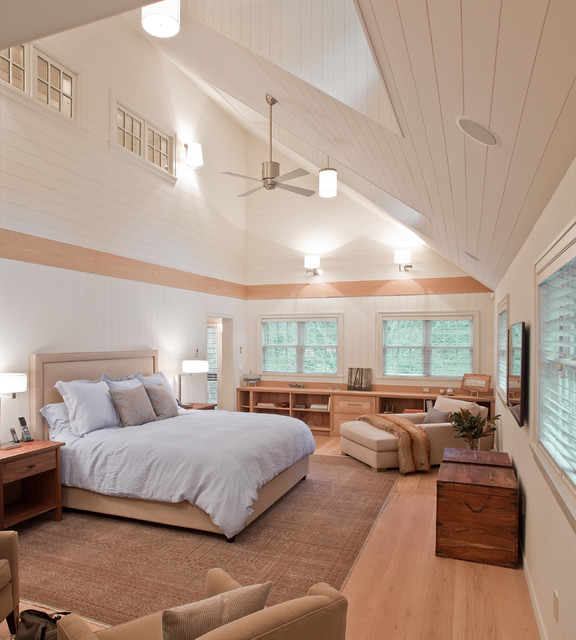 Example of a transitional master light wood floor bedroom design in Boston with white walls