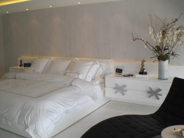master bedroom in white and silver