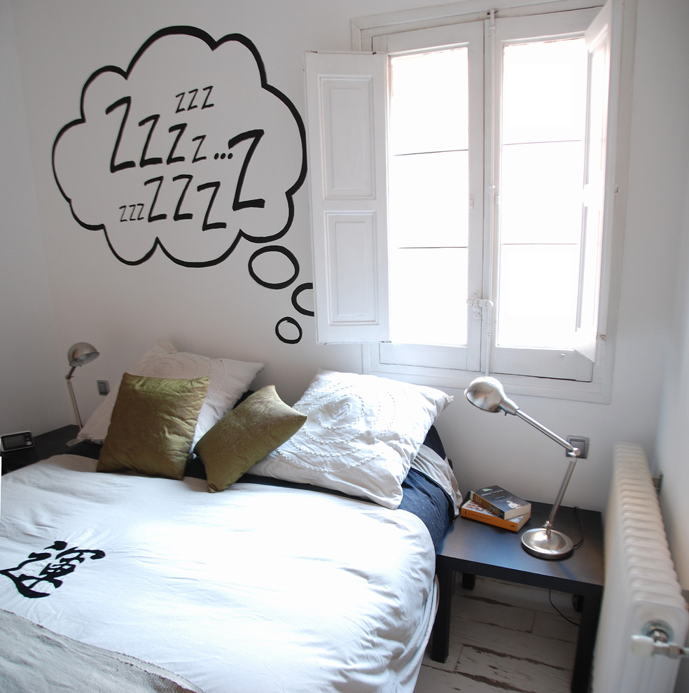 Bedroom - contemporary painted wood floor bedroom idea in San Francisco with white walls