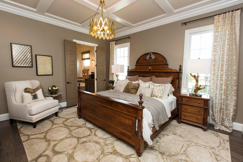 Inspiration for a large transitional master dark wood floor bedroom remodel in Louisville with beige walls
