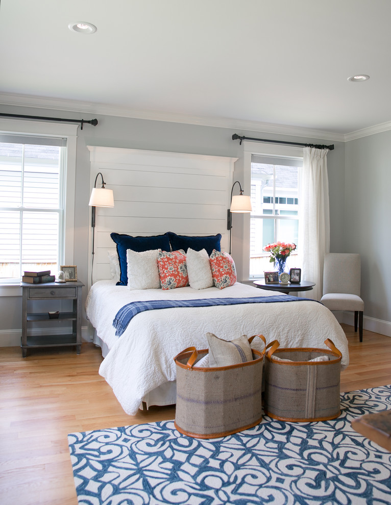 Mid-sized transitional master light wood floor bedroom photo in Portland Maine with gray walls