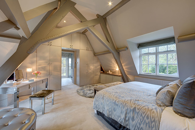 Inspiration for a large farmhouse master carpeted bedroom remodel in Surrey  with white walls