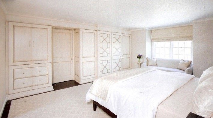 Inspiration for a large modern master dark wood floor bedroom remodel in Boston with white walls and no fireplace