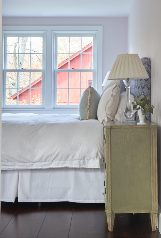 Inspiration for a large farmhouse master dark wood floor and brown floor bedroom remodel in New York with pink walls