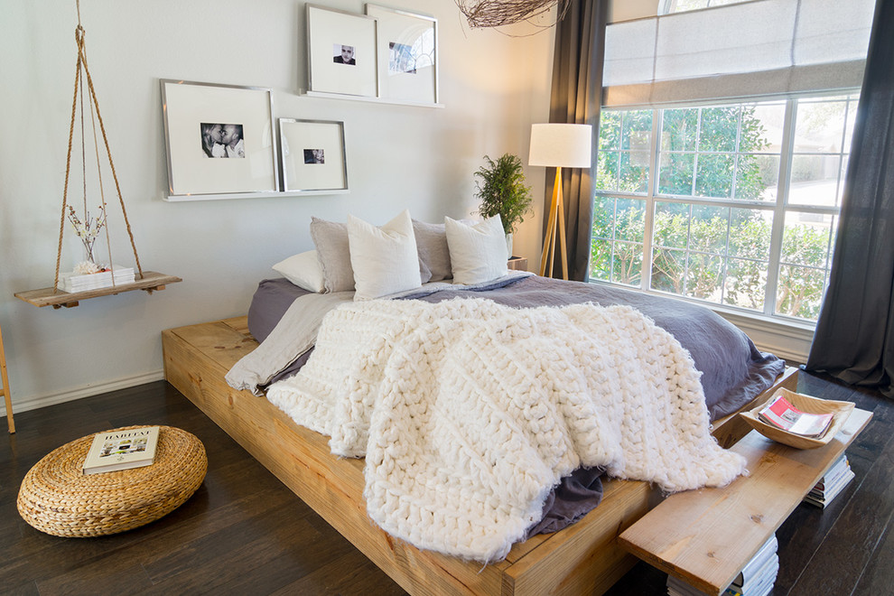 Inspiration for a mid-sized scandinavian master dark wood floor bedroom remodel in Dallas with no fireplace and white walls
