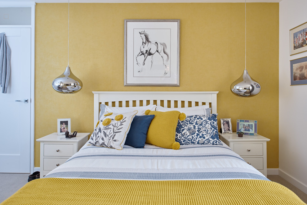 Mid-sized transitional master carpeted and beige floor bedroom photo in Berkshire with yellow walls