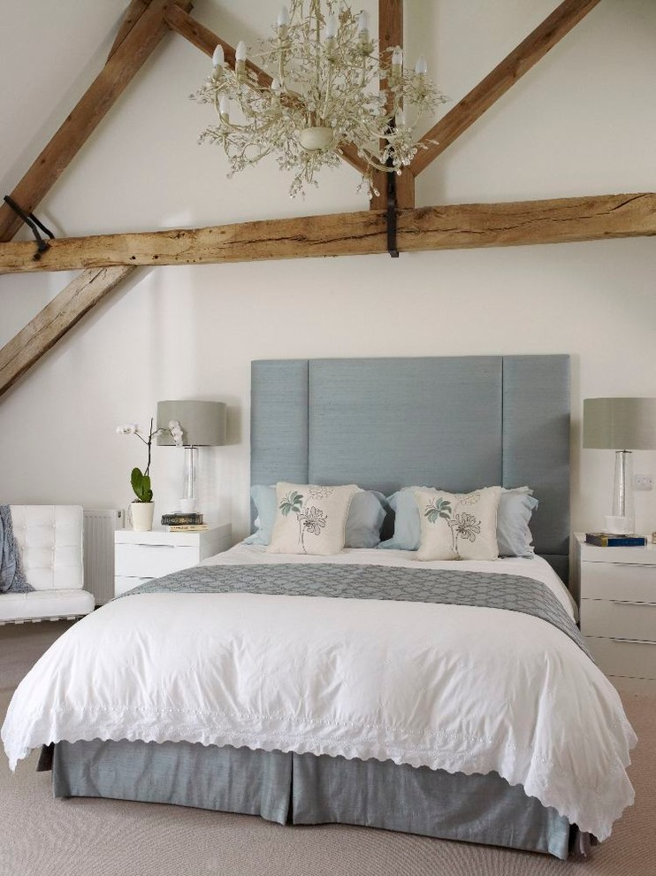 Example of a farmhouse bedroom design in Other with white walls