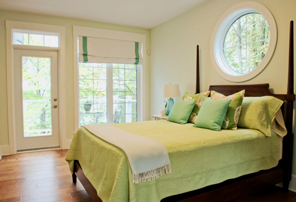 Inspiration for a mid-sized contemporary master medium tone wood floor and brown floor bedroom remodel in Other with green walls and no fireplace