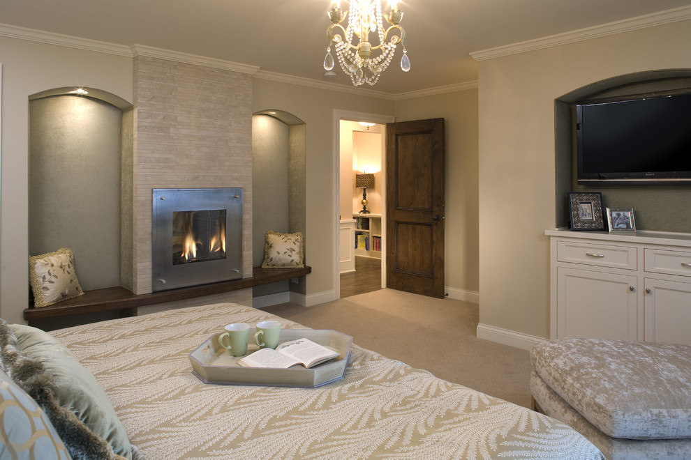 Large trendy master carpeted bedroom photo in Minneapolis with a tile fireplace and a standard fireplace