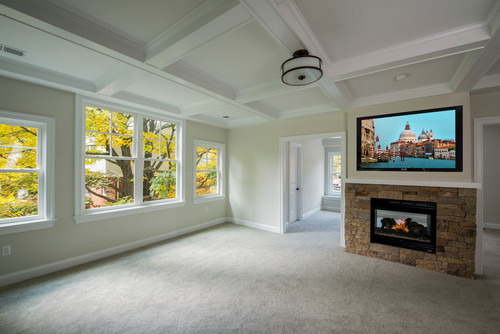 Master Bedroom with Coffered Ceilings and Double Sided Fireplace