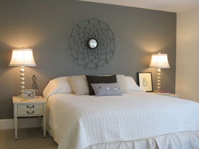 master bedroom with painted wall headboard eclectic