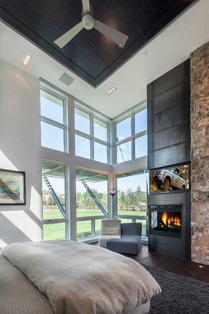 Master Bedroom With Steel Stone Fireplace