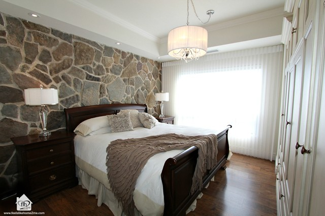 Master Bedroom With Stone Wall Feature Contemporary