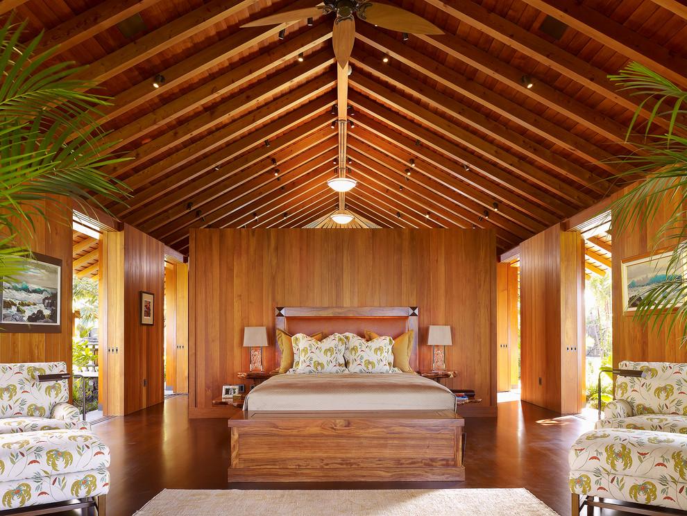 Example of an island style medium tone wood floor bedroom design in San Francisco