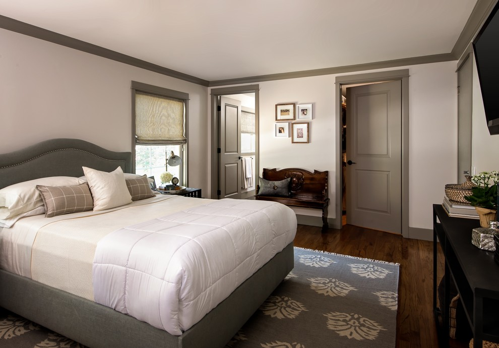 Example of a transitional dark wood floor bedroom design in Birmingham with white walls and no fireplace