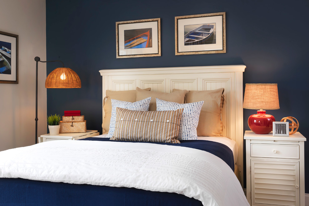 Inspiration for a mid-sized coastal bedroom remodel in Boston with blue walls