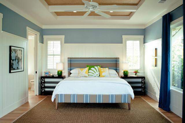Large Island Style Medium Tone Wood Floor And Brown Floor Bedroom Photo In  Hawaii With Blue