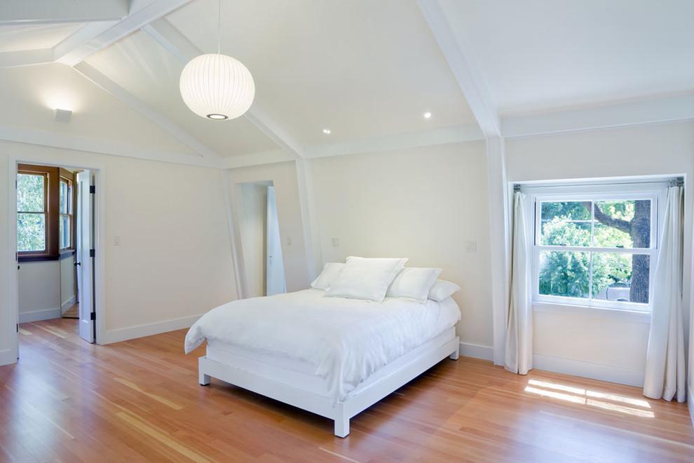 Bedroom - shabby-chic style medium tone wood floor bedroom idea in San Francisco with beige walls