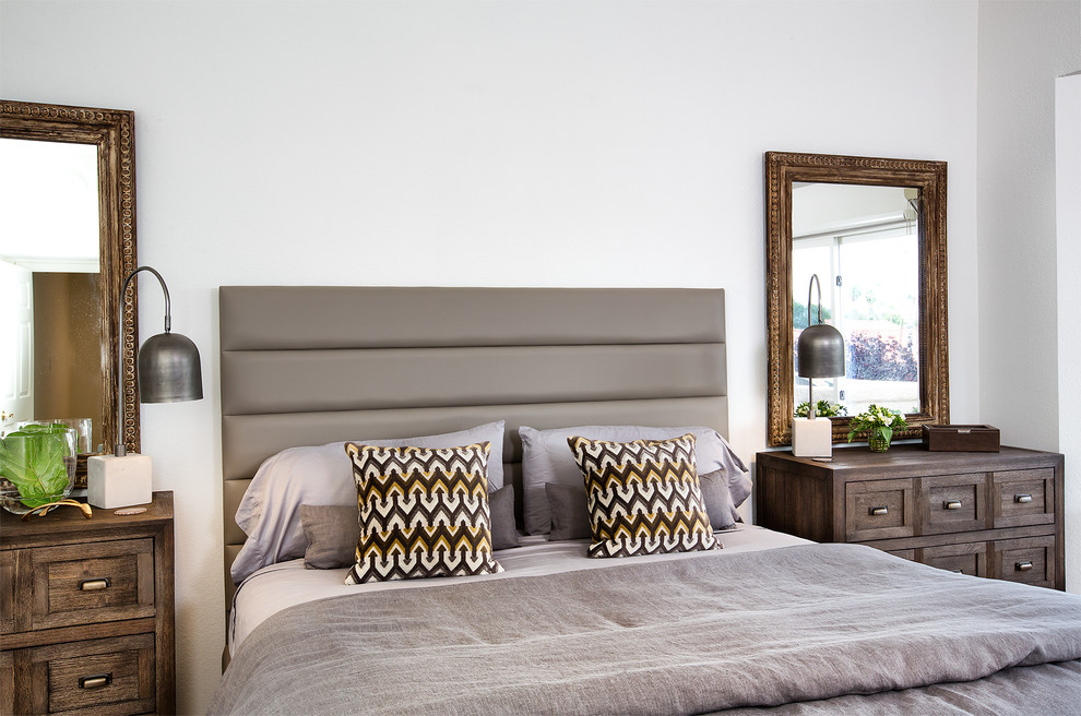 Example of a large trendy master bedroom design in Phoenix with white walls